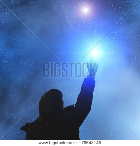 Girl looking at the stars under the dark sky.