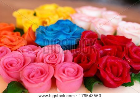 detail of colored marzipan roses on the cake