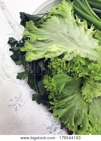the green salad in the spring on the table