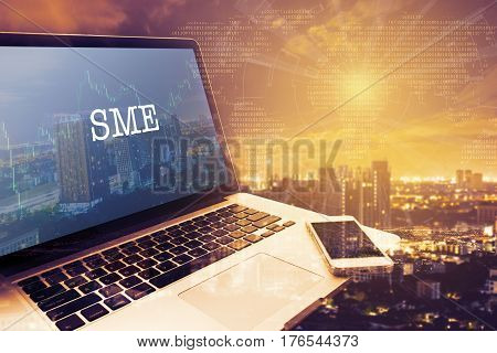 SMEs (SMALL AND MEDIUM-SIZED ENTERPRISES): Grey screen laptop computer. Vintage effects. Digital Business and Technology Concept.