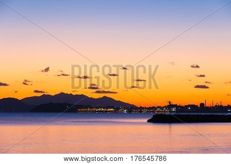 Sunsen in winter on the sea looking at the Piombino channel