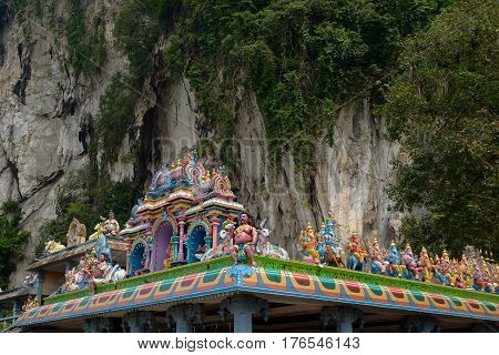 Kuala Lumpur Malaysia - November 3 2014: Statues of Hindu gods on the roof of the temple next to Batu Caves - a complex of cave hills and Hindu shrines at a distance of 13 km from the center of Kuala Lumpur.