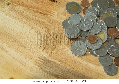 Coins and wood table background. include multi coins type.