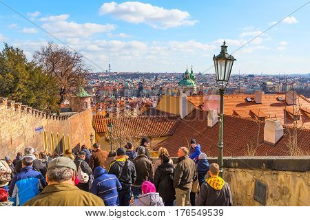 Prague, Czech Republic - February 25, 2017: People at staircase going down from panorama viewpoint at Prague castle, landmarks panorama of the city