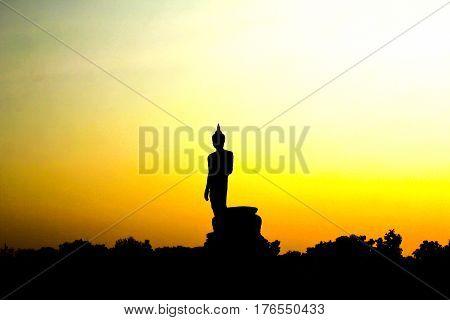 Sunset in Buddhist park in the Phutthamonthon district Buddhamonthon. Nakhon Pathom Province of Thailand. (Silhouette of Buddha)