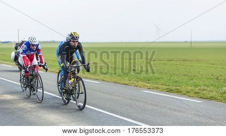 Le Gaut Saint DenisFrance- March 72016:Four cyclists in the breakaway riding in Eure et Loire region of France during the first stage of Paris-Nice 2016.