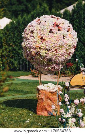 Landscape design. Hot-air baloon figure made form roses. Garden docoration.