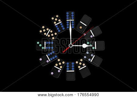 Round office clock, black dominoes principle on black