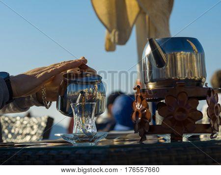 Pouring Tea To A Turkish Tea Glass