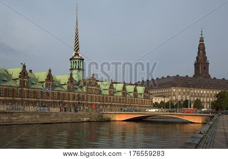 Panoramic view on Christiansborg Palace and Stock Exchange over the channel in Copenhagen Denmark Copenhagen Denmark on the Nyhavn Canal.