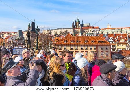Prague, Czech Republic - February 25, 2017: People at panorama viewpoint and famous landmarks of Prague panoramic view