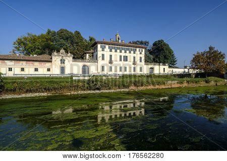 Cassinetta di Lugagnano (Milan Lombardy Italy): facade of the historic Villa Visconti Maineri along the canal known as Naviglio Grande of Turbigo