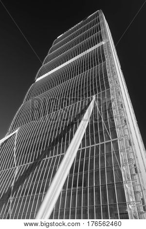 MILAN, ITALY - OCTOBER 4, 2016: Milan (Lombardy Italy): skyscraper known as Allianz Tower one of the three towers in Citylife. Black and white