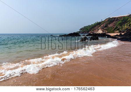 Quiet waves on the Vagator beach Vasco da Gamma. Goa India.