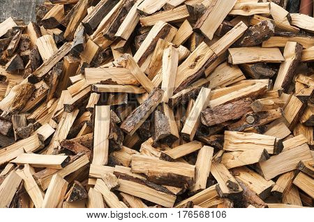 Pile of cut and cleaved firewood closeup as background
