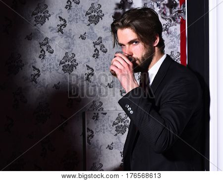 Bearded Man, Businessman In Suit, Red Tie Holds Whiskey Glass