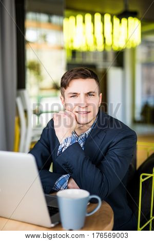 Male Freelancer Connecting To Wireless Via Laptop Computer, Thoughtful Businessman Work On Net-book