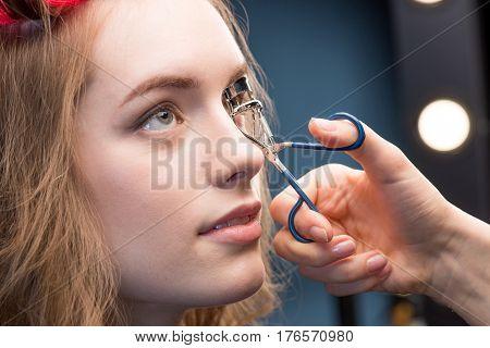 Makeup Artist Correcting Eyelashes