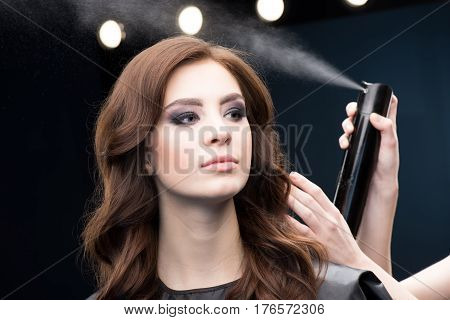 Hairdresser Fixing Hair Of Model