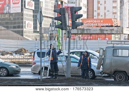The Repair Team Of Electricians Troubleshoots Governing The Traffic Lights At The Intersection