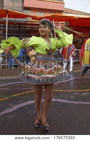 ORURO, BOLIVIA - FEBRUARY 25, 2017: Traditional Bolivian dancer in colourful costume parading through the mining city of Oruro on the Altiplano of Bolivia during the annual Oruro Carnival.