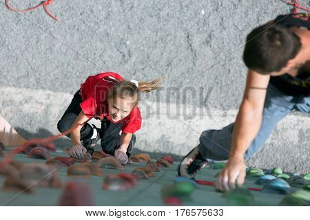 Father and daughter perform speed climbing relay race on vertical wall. Family Climbing Competitions Mother, Father and Me , Dnipro, Ukraine, September 18, 2016