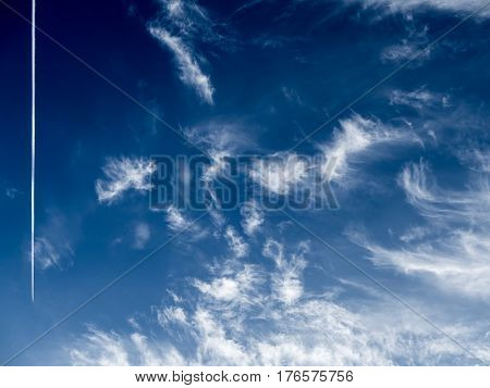 Background of dark clouds before a thunder-storm / Blue rainy clouds / dark clouds in the sky / Ominous and dramatic stormy cloudscape / Dramatic storm cloudscape, with strange cloud shapes