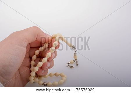 Praying beads of the certain color on a white background