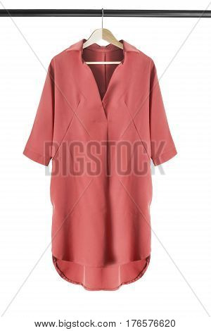 Red dress shirt on wooden clothes rack isolated over white