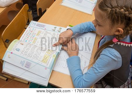 Anapa, Russia - February 28, 2017: First-grader At A Lesson Of Mathematics Reading Job Running His F