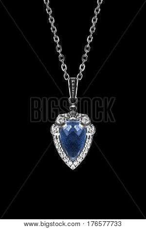Blue sapphire pendant on silver chain isolated over black