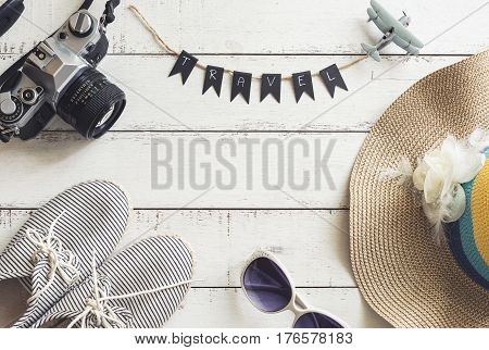 Overhead view of Traveler's accessories and items on white wooden table and copy space, Travel concept