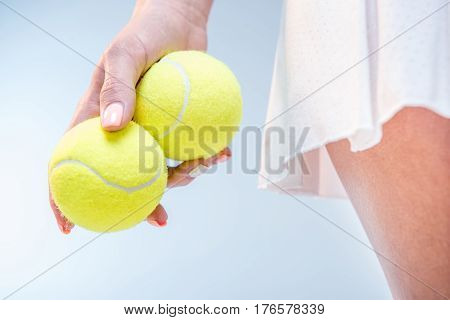 Female Tennis Player With Balls