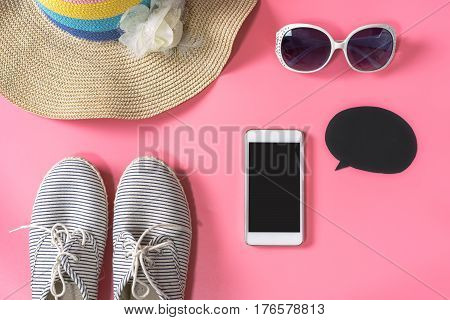 Woman handbag with makeup cellphone and accessories isolated on pink background Fashion concept