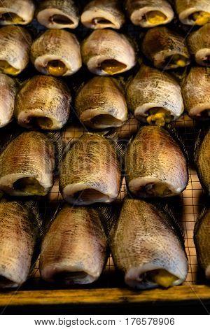 Dried salted snake skin gourami fish on Thailand market