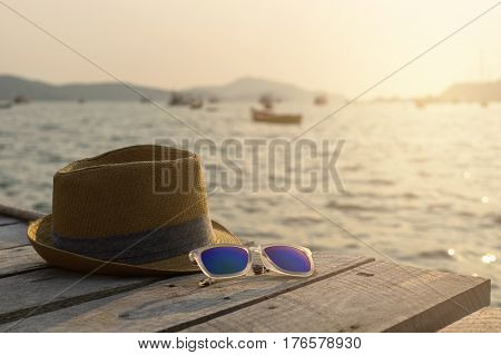 Hat and glasses on wooden bridge Seaside and summer vacation