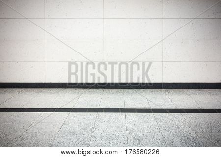 Perspective flooring tile and block wall background.