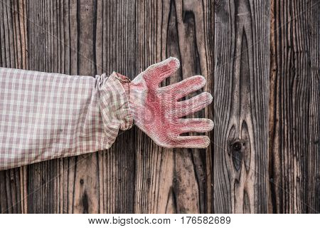 vintage hand with wood background and texture