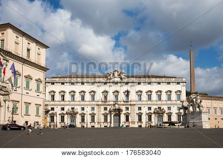 ROME ITALY - July 25 2015: The Piazza del Quirinale sits atop Quirinal Hill the highest of the Seven Hills of Rome. It contains Quirinal Palace which is home to Italy's president the Palazzo della Consulta and an obelisk with large statues.