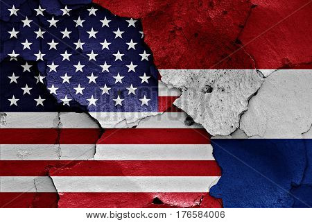 Flags Of Usa And Netherlands Painted On Cracked Wall