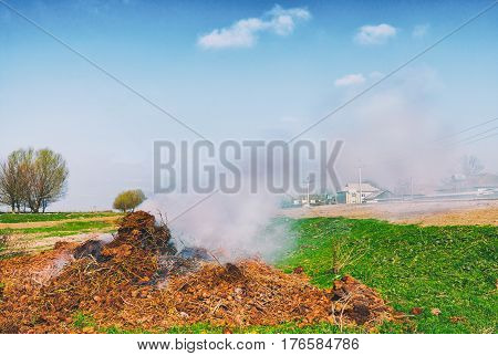 Environmental pollution. Thick pungent smoke from burning garbage