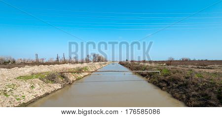 Irrigation canal on farmer fields. Water for irrigation of fields