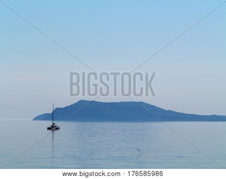 Minimal View Of The Sea, Crimea. Morning Seascape With A Lonely Boat Floating In The Middle Of The S