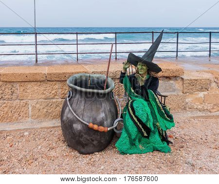 Participant Of Festival Dressed As Witch Sits On The Embankment