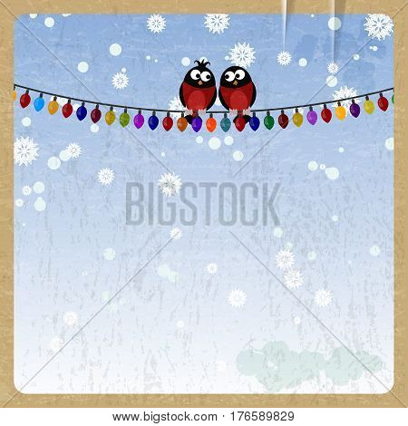 Two bullfinch on a Christmas garland on vintage background