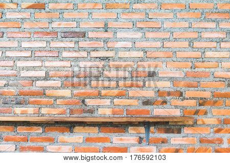 Wood shelf on red brick wall texture background. empty wooden shelf for product display