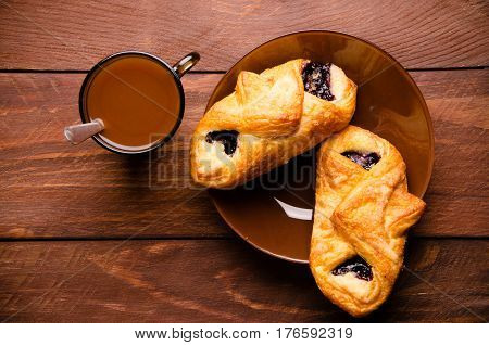 Sweet Buns With Blueberry Jam On Wooden Boards. Hot Chocolate With Appetizing Buns