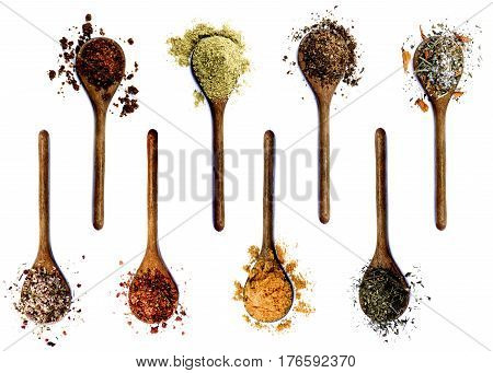 Collection of Various Spices in Wooden Spoons: Dried Paprika Cumin Powder Salt with Petals with Chili and with Cayenne Pepper Curry Powder and Thyme isolated on White background