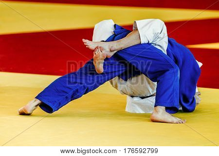 grip feet fighter judoka in competition judo