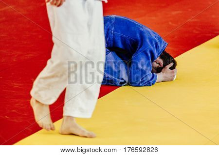 defeat fighter judoka in blue kimono for competition judo